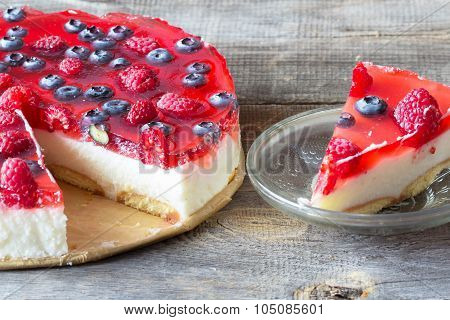 Cheesecake With The Fresh Raspberries And Blueberries
