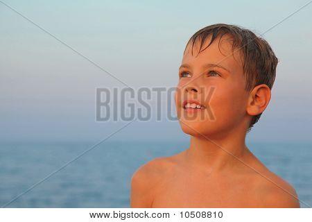 head of little boy after swimming is on seashore