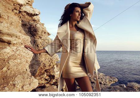 Pretty Woman Wears Elegant Gold Dress And Wool Coat