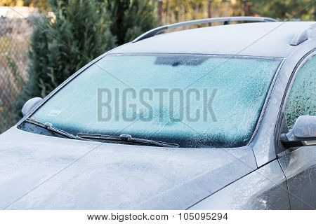 car covered with frost. Cold, white morning