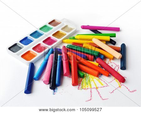Watercolours and heap of colourfull crayons