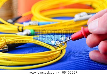 Engineer Testing Fiber Optic Cables.