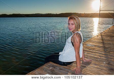 Latina beauty sitting at sunset