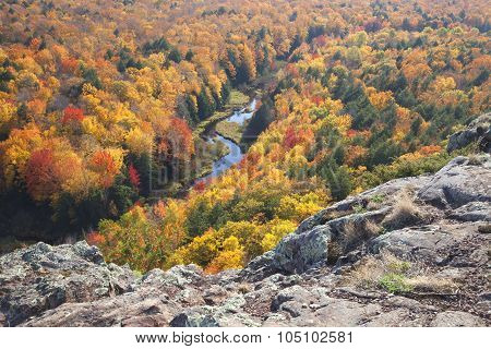 Trees In Full Autumn Color And A Small River Viewed From Rocky Overlook