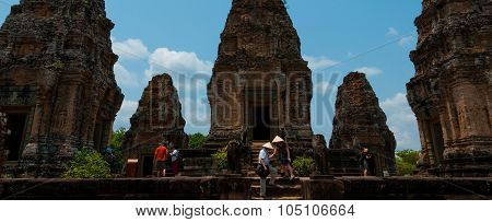 Five stone temples with people