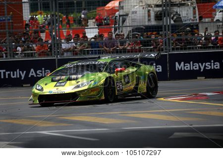 KUALA LUMPUR, MALAYSIA - AUGUST 08, 2015: Vincent Wong drives a Lamborghini Huracan Super Trofeo LP620 car takes turn 2 in the KL City GT CUP Race of the 2015 Kuala Lumpur City Grand Prix.