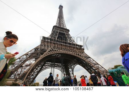Paris - April 27:locals And Tourists At Eiffel Tower, Stands 324 Metres (1,063 Ft) Tall. Monument Wa