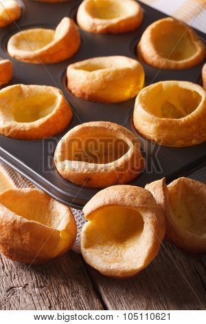 Yorkshire Puddings In Baking Dish Close Up On The Table. Vertical