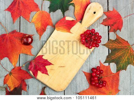 Autumn Leaves And Harvest On A Wooden Background