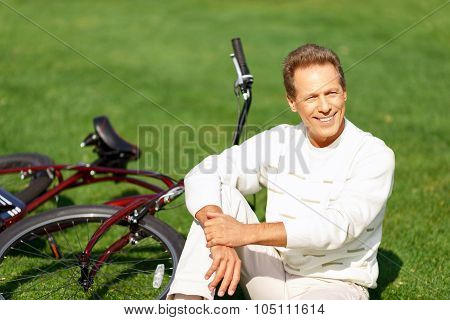 Adult man riding a bicycle
