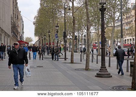 Paris, April 27: Local And Tourisrs On The Avenue Des Champs-ely