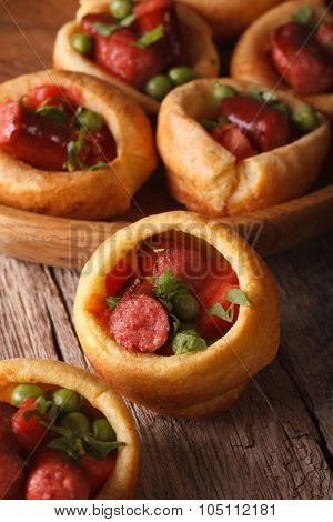 Yorkshire Puddings Stuffed With Sausages Close-up. Vertical
