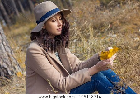 Stylish Girl In An Autumn Coat And Hat