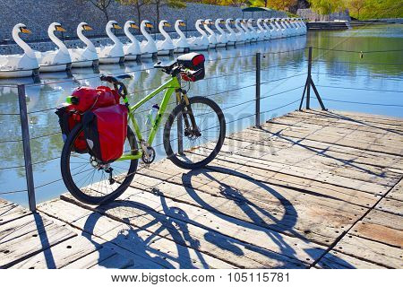 MTB Bicycle touring bike in a park with pannier racks and saddlebag