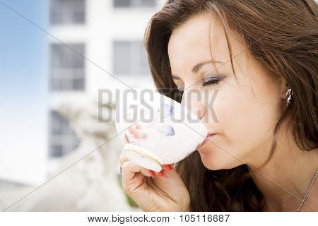 Beautiful Woman Enjoying A Cup Of Tea
