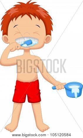 Young boy is brushing her teeth in the bathroom