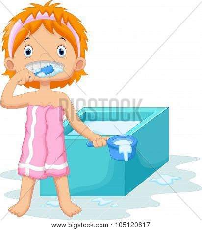 Young girl is brushing her teeth in the bathroom