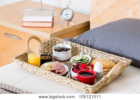 Breakfast Tray On Unmade Bed In Hotel Room