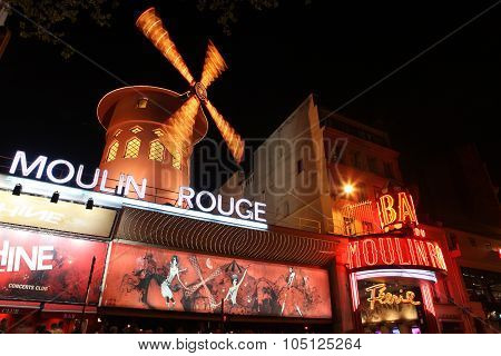 Paris - May 3: The Moulin Rouge At Night, On May 3, 2013 In Paris, France. Moulin Rouge Is A Famous