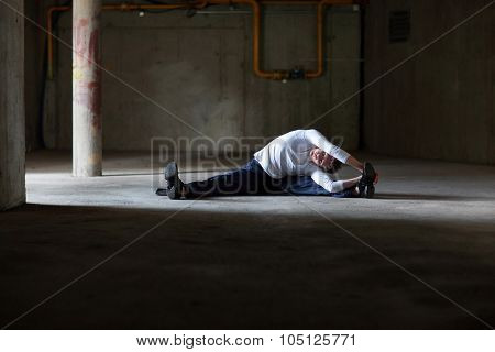 fit man stretching in dark space