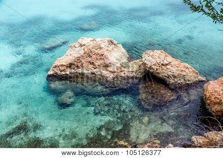 Clear Aqua Water Around Rocks