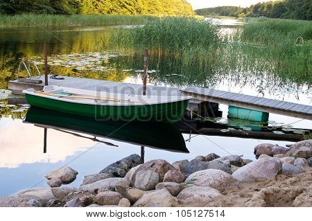 Rowboat Stored Near Wooden Jetty