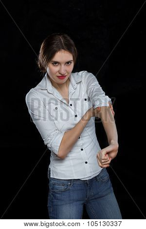 Young casual woman isolated over black background