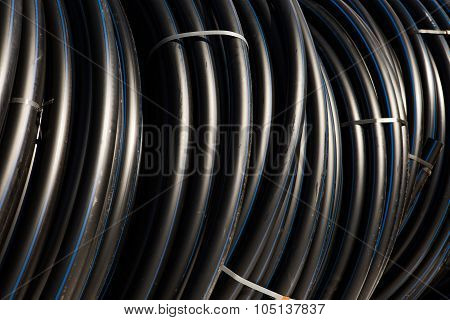 Background of black plastic pipes
