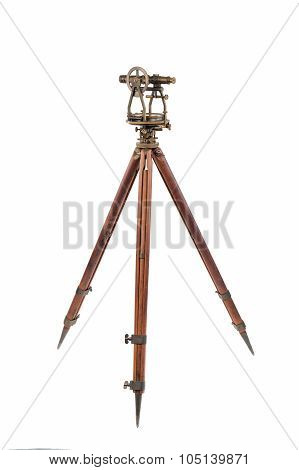 Vintage Surveyor's Level (Transit, Theodolite) on a Wooden Tripod isolated on White.