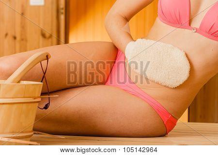 Closeup Of Woman In Sauna With Exfoliating Glove.