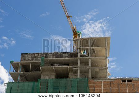 Crane And Building Construction Site With Blue Sky , Focus Crane.
