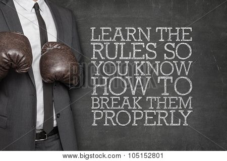 Learn the rules so you know how to break them properly on blackboard with businessman on side