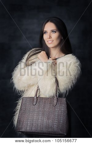 Beautiful Winter Woman in Fur Coat with Bag