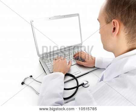 Rear View Of A Young Doctor With Laptop