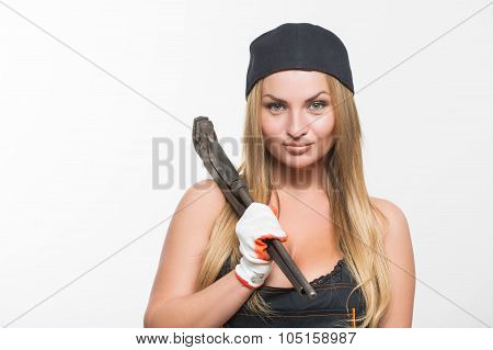 Young girl with a wrench in his hand.