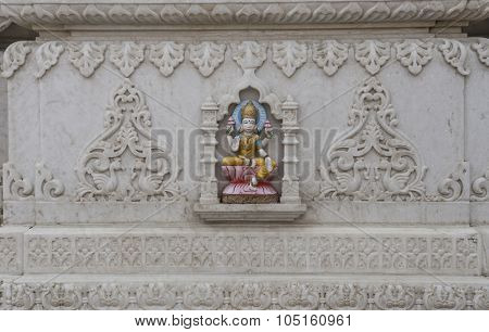 Engraved sculpture of Goddess Laxmi on the marble temple.