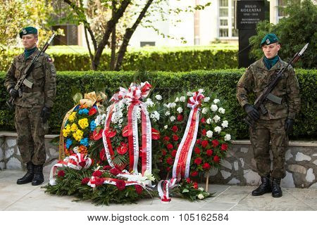 KRAKOW, POLAND - MAY 3, 2015: Polish soldiers at ceremony of laying flowers to monument to Hugo Kollataj during annual Polish national and public holiday the May 3rd Constitution Day (of May 3, 1791)