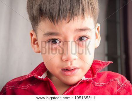 Little boy crying with sadness