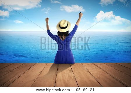 Female Tourist Sit On The Wooden Dock