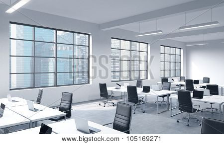 Corporate Workplaces Equipped By Modern Laptops In A Modern Panoramic Office With Singapore View. Bl