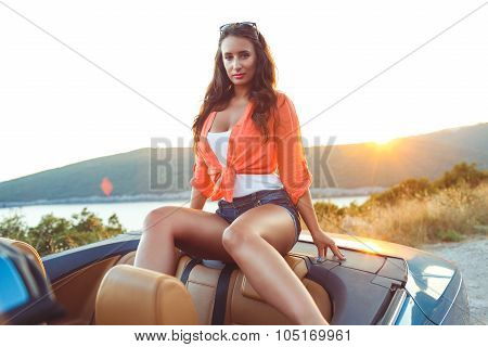 Beautiful Woman Sitting In Cabriolet, Enjoying Trip On Luxury Modern Car With Open Roof