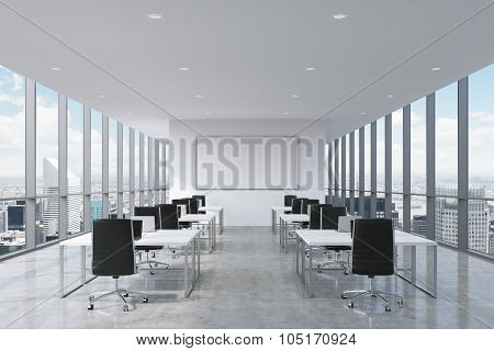A Symmetric Corporate Workplaces Equipped By Modern Laptops In A Modern Panoramic Office In New York