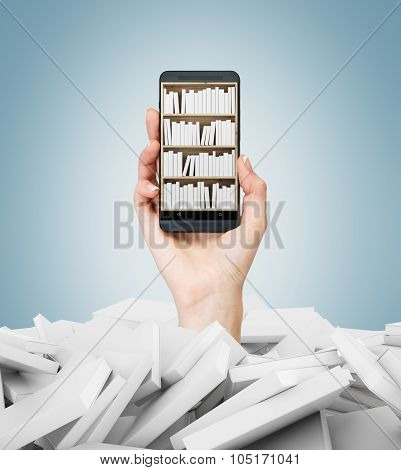 A Hand Holds A Smartphone With A Book Shelf On The Screen. A Heap Of Books With White Covers. A Conc