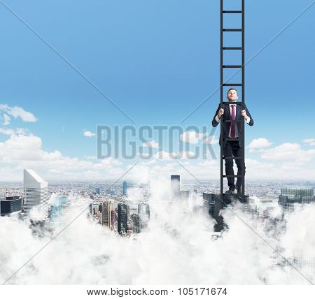 A Businessman Is Climbing Up The Ladder. Clouds And New York View. The Concept Of The Success.