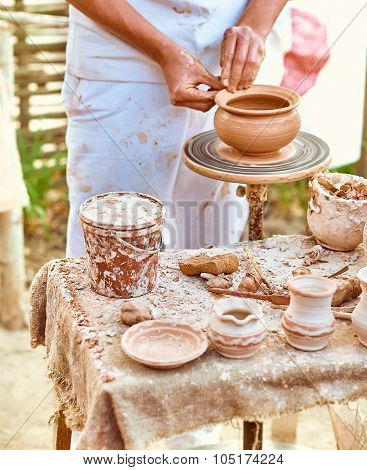 Ethnic art, skilled master creating pot of clay, ceramic, craft