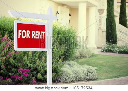 Real estate sign in front of new house for rent