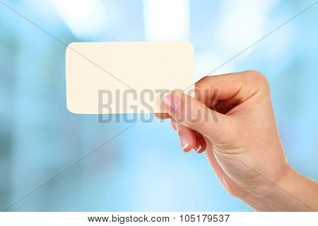 Hand holding blank card  on abstract background