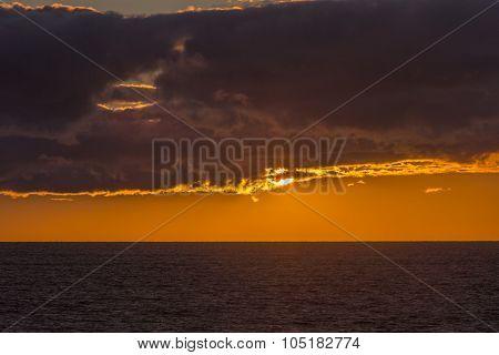 sun emerging from dark cloud, Prince Edward Island