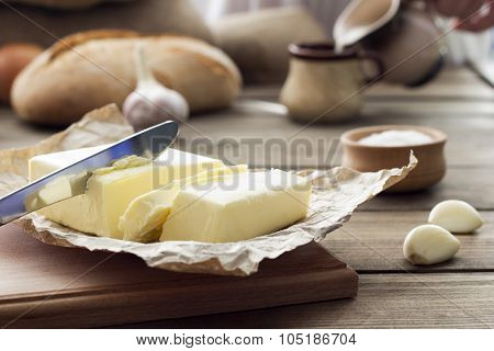 Butter Knife , Bread , Garlic And Milk