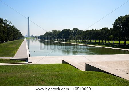 USA, WASHINGTON - AUG 27, 2014: Ducks swim by Lincoln Memorial Reflecting Pool not far from Washington Monument at summer sunny day.